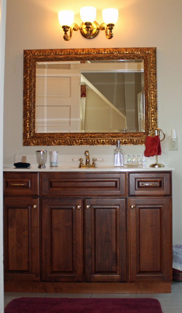 Bathroom vanity with gold-framed mirror